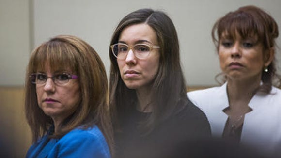 Jodi Arias (center) looks to the jury at the end of