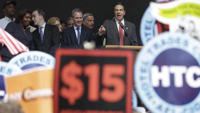 Gov. Andrew Cuomo speaks during a July 22 rally after the New York Wage Board endorsed a proposal to set a $15 minimum wage for workers at fast-food restaurants with 30 or more locations.