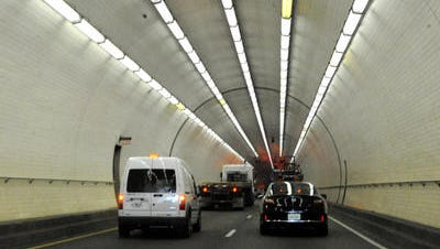 Traffic crawls through Wallace Tunnel on Interstate 10 beneath the Mobile River in Mobile in this Dec. 11, 2014, file photo.