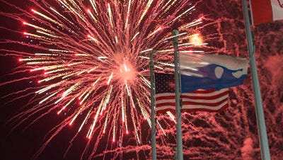 Fireworks frame the flags during the Ocean City show at North Division Street.