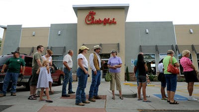 In this 2012 photo, patrons of the Chick-fil-A restaurant in Fort Collins line up to place their food orders.