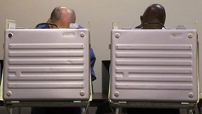 Voters exercising their right at  the voting booth
