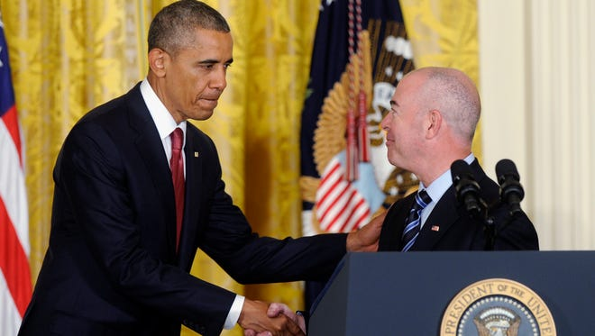 President Obama shakes hands with Deputy Homeland Security Secretary Alejandro Mayorkas after he administered the oath of allegiance during a naturalization ceremony for active duty service members and civilians on July 4, 2014, in the East Room of the White House.
