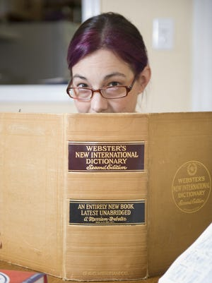 Collingswood resident Kory Stamper is a lexicographer with Merriam Webster. She is one of a dozen or so language experts who vet words into the Merriam Webster dictionary. Wednesday, September 12, 2012.