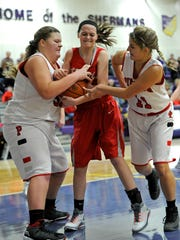 Westfall's Kenzie Peters struggles for the ball with Piketon's Summer Travis, left and Sami Grooms, right, during the SVC basketball preview on Friday at Unioto.