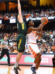 SYRACUSE, NY - NOVEMBER 02: Franklin Howard #1 of the Syracuse Orange drives to the basket against the defense of Connor Mahoney #33 of Le Moyne Dolphins during the first half at the Carrier Dome on November 2, 2015 in Syracuse, New York. (Photo by Rich Barnes/Getty Images)