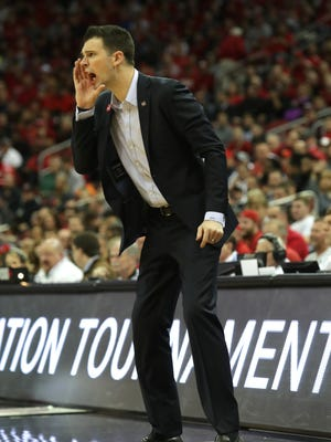 Louisville's interim coach David Padgett yelled at his team as they fell behind Mississippi State. March 20, 2018.