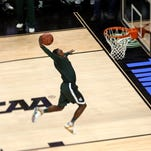 Michigan State's Lourawls Nairn Jr. goes up to dunk during practice for an NCAA college basketball tournament second round game in Charlotte, N.C., Thursday, March 19. Michigan State plays Georgia on Friday.