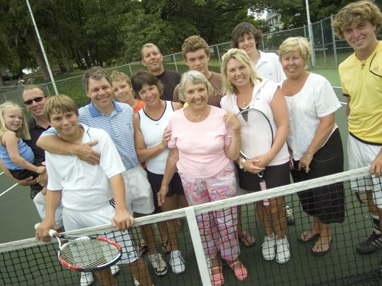 Members of the Carter family pose for a photograph on the tennis courts at Mary Baldwin College close to the start of the AMC/News Leader Tennis Tournament on Sunday, July 29, 2007. From Left: Kate Zimmer, Paul Zimmer, Stuart Carter, Rob Carter, Michael Heath Carter, Katie Zimmer, Alex Carter, Kit Carter, Sam Zimmer, Anne Carter Smith, Hunter Carter, Bev Coffman and Gus Zimmer.