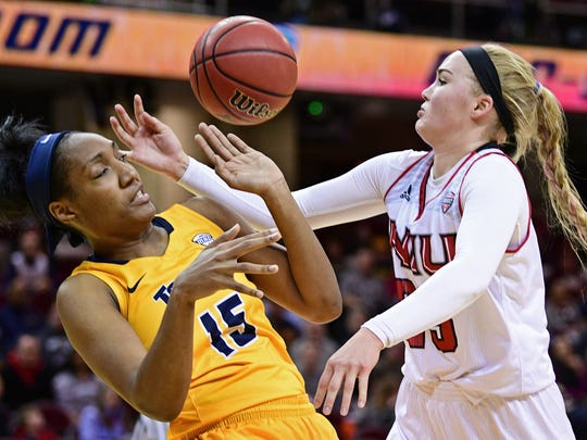 Toledo Rockets center Kaayla McIntyre (15) and Northern Illinois forward Kelly Smith (25) fight for a rebound during the second quarter of an NCAA college basketball game in the Mid-American Conference tournament championship, Saturday, March 11, 2017, in Cleveland, Ohio.