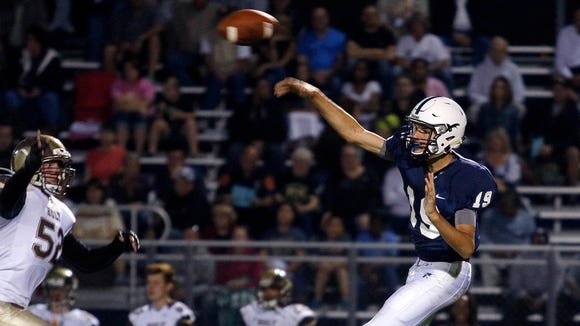 East Lansing's Hunter Helmic threw for 127 yards in a win over Everett on Friday.
