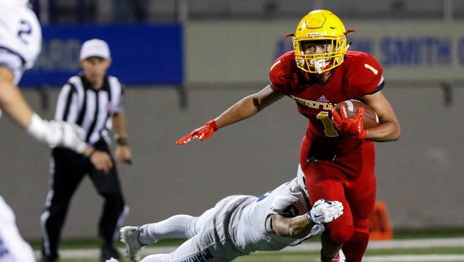 Palma's Anthony Villegas carries the ball during an CCS conference football game between the Palma Chieftains and the Aptos Mariners at Rabobank Stadium on Friday, September 22. 2017 in Salinas, Calif. Vernon McKnight/for The Californian