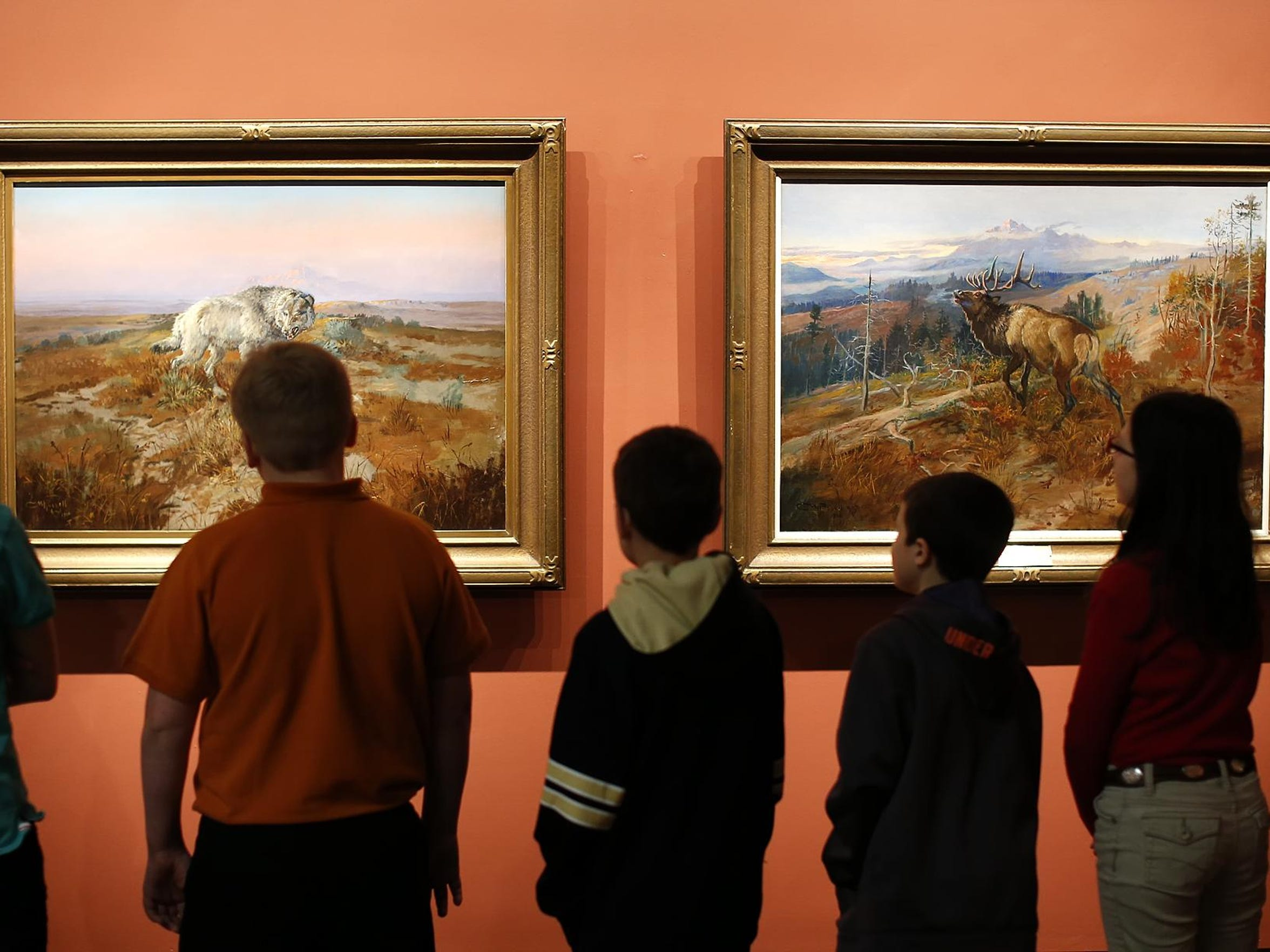 Students from Foothills Community Christian School look at Charlie Russell paintings at the C.M Russell Museum.