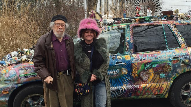 Poet Gerd Stern and artist Lalainya Borre stand beside her car during a visit to the former USCO church in Garnerville.