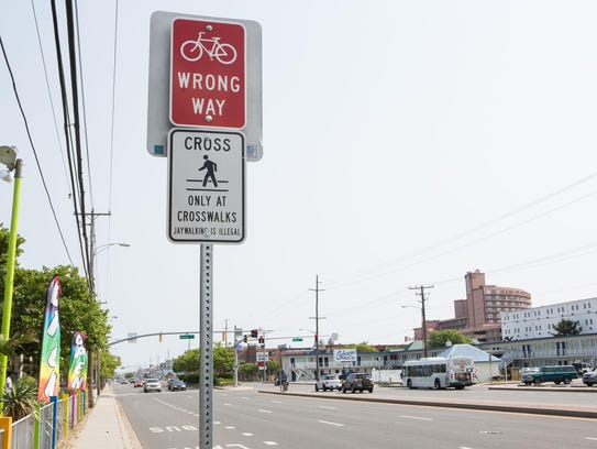 Signs are used to encourage Ocean City pedestrians