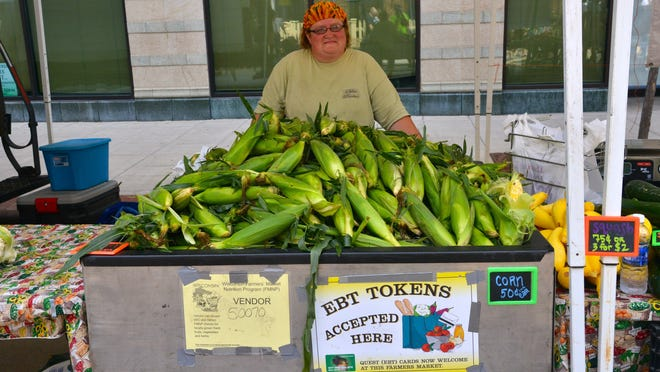 Tracy Binz from Olden Produce, a vendor at the Oshkosh Farmers Market, helped support funding for the Bonus 10 Food Bucks program.
