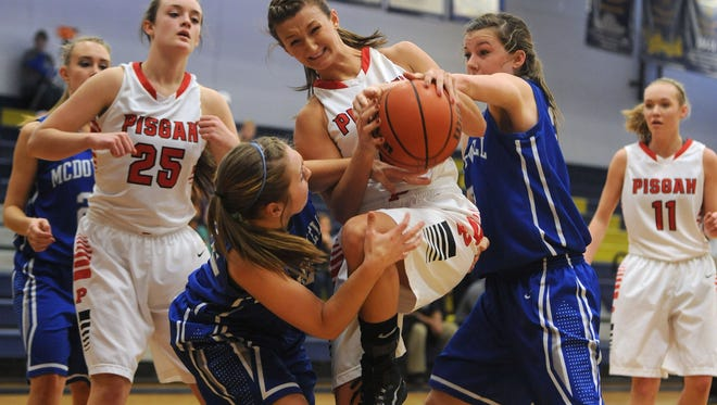 Pisgah's Brooklyn Allen battles McDowell players for a rebound during a nonconference game last month.