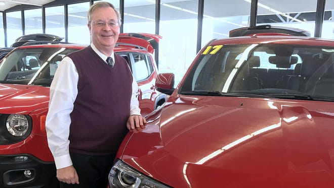 Don Ferrario, president of Ferrario Auto Team, stands in the existing showroom of his Chrysler-Dodge-Jeep-Ram dealership in Horseheads.