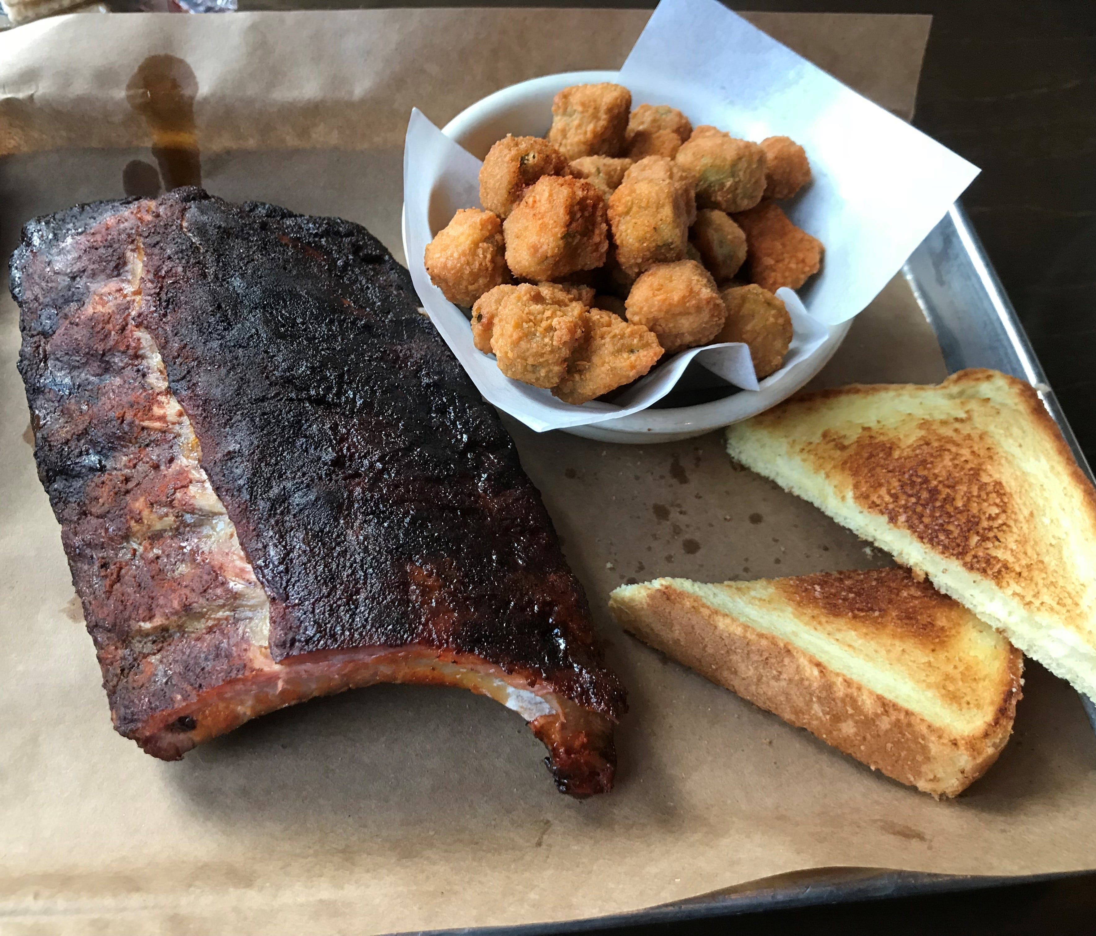 Doc Crow's has a full barbecue smoker operation that churns out specialties like St. Louis-style pork ribs, served with fried okra and white bread.