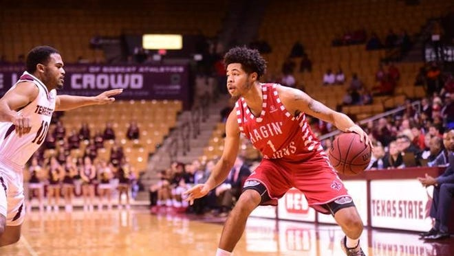 UL's Malik Marquetti dribbles the ball while trying to get past a Texas State defender as the Ragin' Cajuns take on the Bobcats Saturday Jan. 20, 2018.