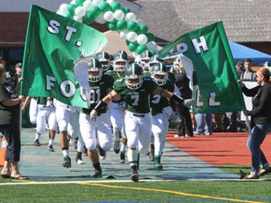 St. Joseph football team takes the field for a game last season