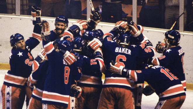 USA hockey team celebrates after defeating Finland for the gold medal during the 1980 Winter Olympics in Lake Placid. Team captain Mike Eruzione is at far left.