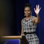 First lady Michelle Obama waves after speaking at the Celebrating Innovations in Career and Technical Education event at the White House.
