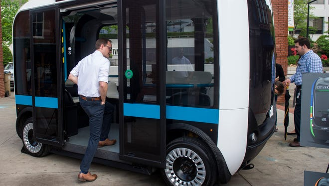People take a look at Olli, Local Motors' self-driving bus that will be brought to Knoxville, during an announcement event in Market Square on Thursday, April 20, 2017.