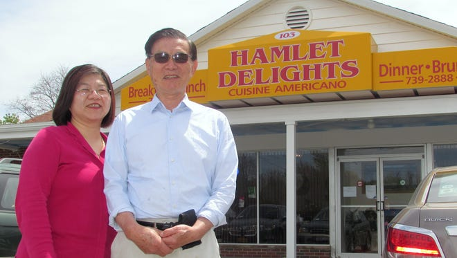 Owner Catheryne Chen and her father Yang Chen stand in front of her new Horseheads restaurant, Hamlet Delights.