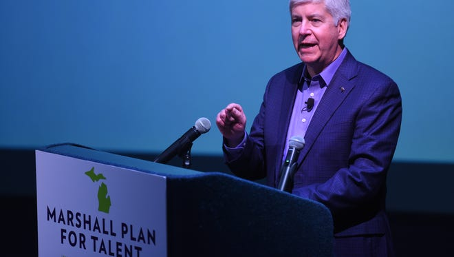 Governor Rick Snyder speaks to a large crowd at the Michigan Science Center about the Marshall Plan for developing talent in Detroit on February 22, 2018.