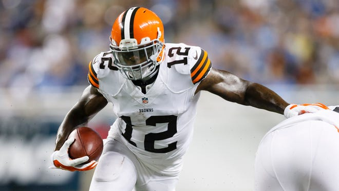 Cleveland Browns wide receiver Josh Gordon (12) runs the ball against the Detroit Lions during a preseason NFL football game at Ford Field in Detroit, Aug. 9, 2014.