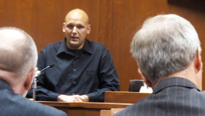 Jason Tinnes testifies during the first-degree murder trial of Seth Techel on Tuesday, July 22, 2014 in Davenport, Iowa. Tinnes admitted that he had an affair with murder victim Lisa Techel, but that he wasn't responsible for her May 2012 death.
