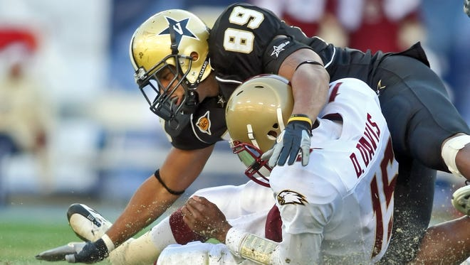 Boston College quarterback Dominique Davis is tackled by Vanderbilt defensive end Teriall Brannon during the 2008 Music City Bowl at LP Field.