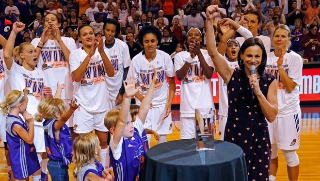 Head coach Sandy Brondello and the Phoenix Mercury celebrate their 96-78 win over the Minnesota Lynx in Game 3 of the WNBA Western Conference finals Tuesday, Sept. 2,  2014 in Phoenix  Arizona.