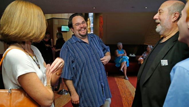 : Republic Media Performing-arts reporter and theater critic Kerry Lengel , center, talks with subscribers as they enjoy a reception during opening night of the Phoenix Symphony Saturday, Sept. 20, 2014 in Phoenix, Ariz
