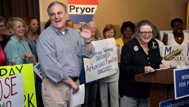 Sen. Mark Pryor, D-Ark., left, is introduced to a group of female supporters by his mother, Barbara Pryor, right, at a rally in Little Rock, Ark., on Aug. 28, 2014.