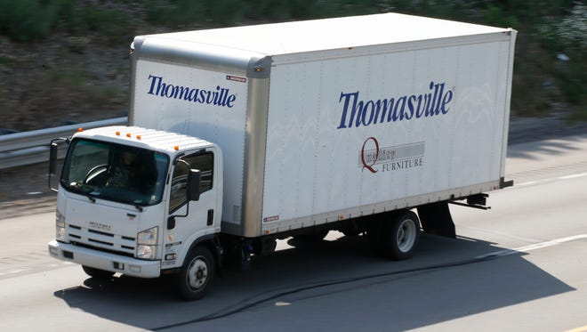 A Thomasville Furniture truck moves through traffic on Interstate 79 near Evans City, Pa., On June 21, 2013.
