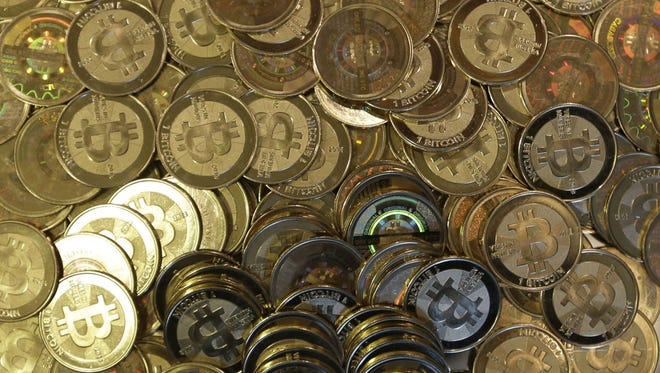 Bitcoin tokens are seen in Sandy, Utah, on April 3, 2013. The website of the major Bitcoin exchange Mt. Gox went offline Feb. 25, 2014, amid reports it suffered a debilitating theft, a new setback for efforts to gain legitimacy for the virtual currency.