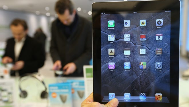 The fourth-generation iPad is shown at a display table at an Apple retailer in Germany in 2012.
