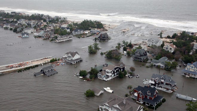 This aerial photo shows damage to the New Jersey shoreline after Superstorm Sandy on Oct. 30, 2012. A new United Nations report warns that, if left unchecked, climate change will increase incidents of coastal flooding.