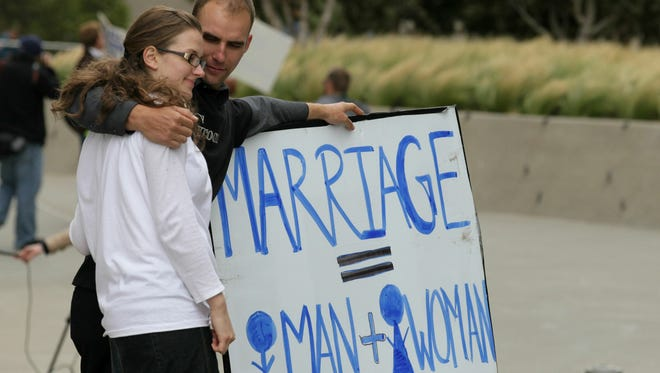 Supporters of Proposition 8, California's ban on same-sex marriage, stand outside a courthouse in August 2010 in San Francisco.