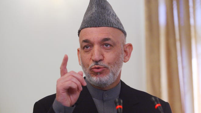 Afghan President Hamid Karzai speaks during a NATO news conference.