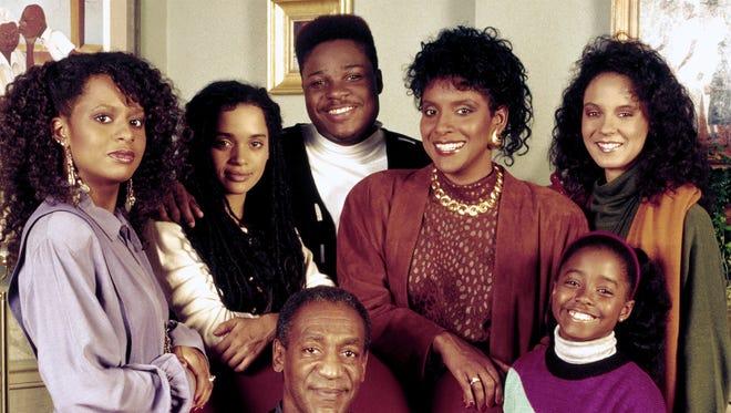 """The Cosby Show"" family, clockwise from bottom, Bill Cosby as Dr. Heathcliff ""Cliff"" Huxtable, Tempestt Bledsoe as Vanessa Huxtable, Lisa Bonet as Denise Huxtable Kendall, Malcolm-Jamal Warner as Theodore ""Theo"" Huxtable, Phylicia Rashad as Clair Hanks Huxtable, Keshia Knight Pulliam as Rudy Huxtable, and Sabrina Le Beauf as Sondra Huxtable Tibideaux."