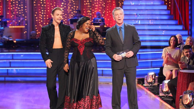 Amber Riley, Derek Hough and host Tom Bergeron on the Oct. 28, 2013 episode of 'DWTS.'