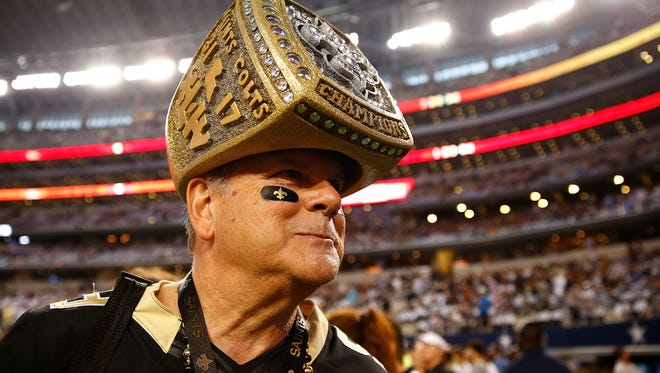 ARLINGTON, TX - SEPTEMBER 28:  A New Orleans Saints fan stands on the sidlelines before the start of the game against the Dallas Cowboys at AT&T Stadium on September 28, 2014 in Arlington, Texas.  (Photo by Tom Pennington/Getty Images)