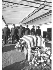 Oregon State Police troopers stand guard next to the casket of superintendent Holly Holcomb, who was shot and killed Nov. 25, 1975 in front of the Public Service Building on the Capitol Mall in Salem. Holcomb is buried at Restlawn Cemetery.