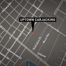 A woman was the victim of a carjacking outside her home Saturday.