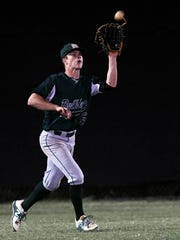 Melbourne's Jared Stevanus tracks down a fly ball in the outfield during Wednesday's game against Merritt Island.