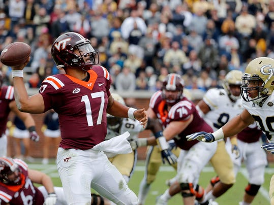 FILE - In this Saturday, Nov. 11, 2017, file photo, Virginia Tech quarterback Josh Jackson, left, throws the ball under the pressure of Georgia Tech's Desmond Branch in the third quarter of an NCAA college football game in Atlanta. Virginia is hoping to put a cap on a successful regular season with a victory against Virginia Tech, on Friday, Nov. 24, 2017. Virginia Tech has won 13 in a row in the series. (AP Photo/David Goldman, File)