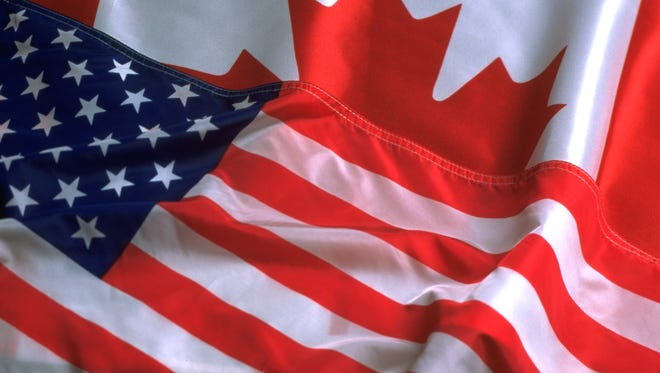 thinkstock canadian flag and american flag